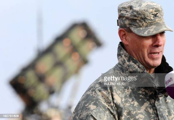 US soldiers commander colonel Steve Richmond speaks during a press conference near a Patriot missile system at a Turkish military base in Gaziantep...