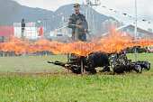 TOPSHOT PLA soldiers crawl under a burning frame as their colleague shouts during a demonstration at the open day of the Chinese People's Liberation...