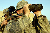 November 14, 2007 - Soldiers demonstrate a buddy sniper position as one of the ways to set up an attack in Iraq. The 506th Expeditionary Security Forces Squadron at Kirkuk Air Base, Iraq, houses a clo