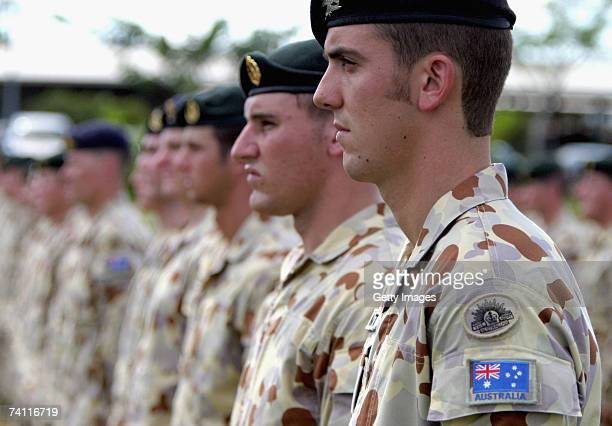 Soldiers deploying to Iraq stand to attention during a parade to farewell 450 Australian troops before their deployment to Iraq May 10 2007 in Darwin...