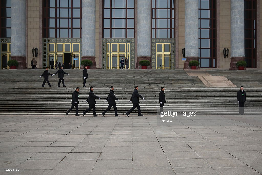 Soldiers dressed as ushers guard in front of the entrance of Great Hall of the People during a pre-opening session of the Chinese People's Political Consultative Conference (CPPCC) on March 2, 2013 in Beijing, China. The reshuffle will be completed at the first annual session of the 12th National People's Congress (NPC), which is scheduled to begin on March 5, and the first annual session of the 12th National Committee of the Chinese People's Political Consultative Conference (CPPCC), which will commence on March 3.