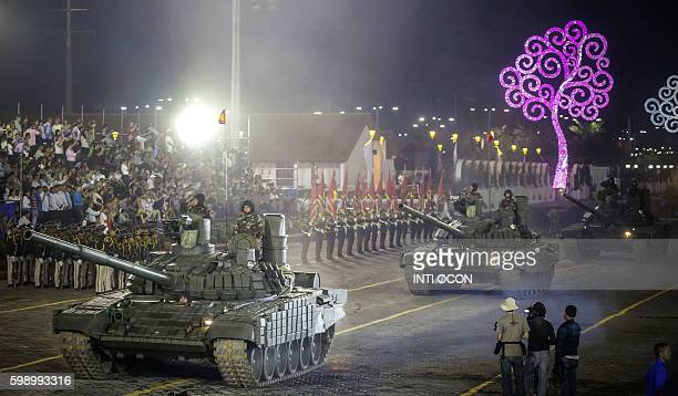 Soldiers drive Russianmade T72B1 main battle tanks purchased by Nicaragua that have sparked controversy and drawn criticism from the opposition...