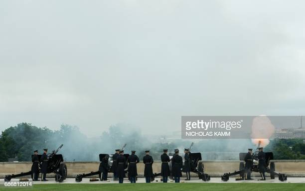 US soldiers fire a 19gun salute during a military parade attended by Defense Secretary Jim Mattis Canadian Defense Minister Harjit Sajjan and Mexican...