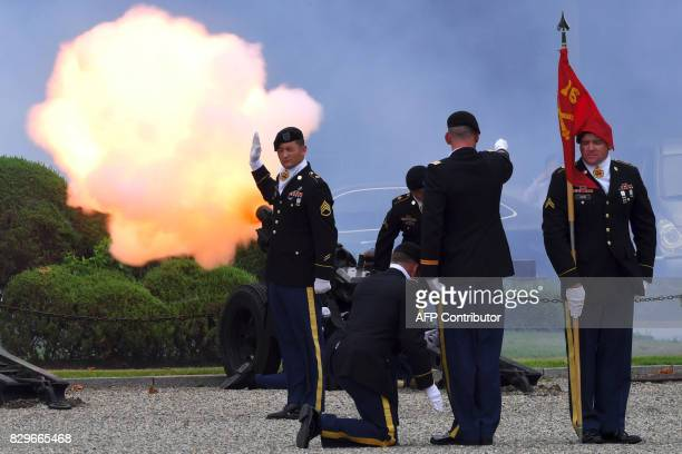 US soldiers fire a salute during a change of command ceremony for South Korea's General Kim ByungJoo incoming deputy commander of ROKUS Combined...