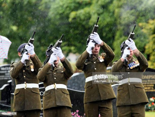 Soldiers fire a volley of shots at the funeral of Lance Corporal Nigel Moffett of the Light Dragoons Regiment is carried for burial at Redburn...