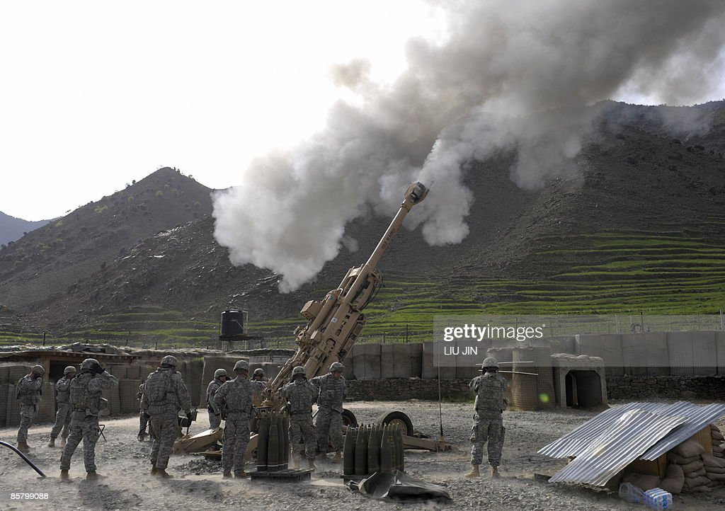 US soldiers fire practice shots using an M777 howitzer at ISAF's Camp Bastick in Naray in Afghanistan's eastern Kunar province on April 4 2009 US...