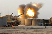 Soldiers fire the howitzers on their M109A6 Paladins.