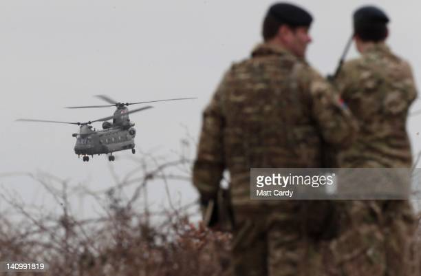 Soldiers from 12 Mechanized Brigade look on as a helicopter takes part in a simulated casualty evacuation at the Ministry of Defence training area at...