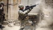 US soldiers from 212 Infantry Regiment out of Colorado Springs fires his gun at Taliban positions during a firefight on June 15 2012 in the Pech...