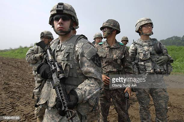 US soldiers from 2nd Battalion 9th Infantry Regiment of the 1st Armored Brigade Combat Team of 2nd infantry division and South Korean soldiers from...
