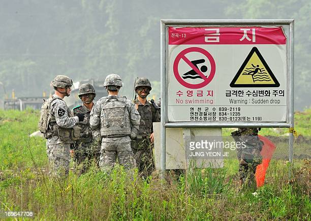 US soldiers from 2nd Infantry Division talk with South Korean soldiers during a USSouth Korea joint river crossing exercise in the border city of...