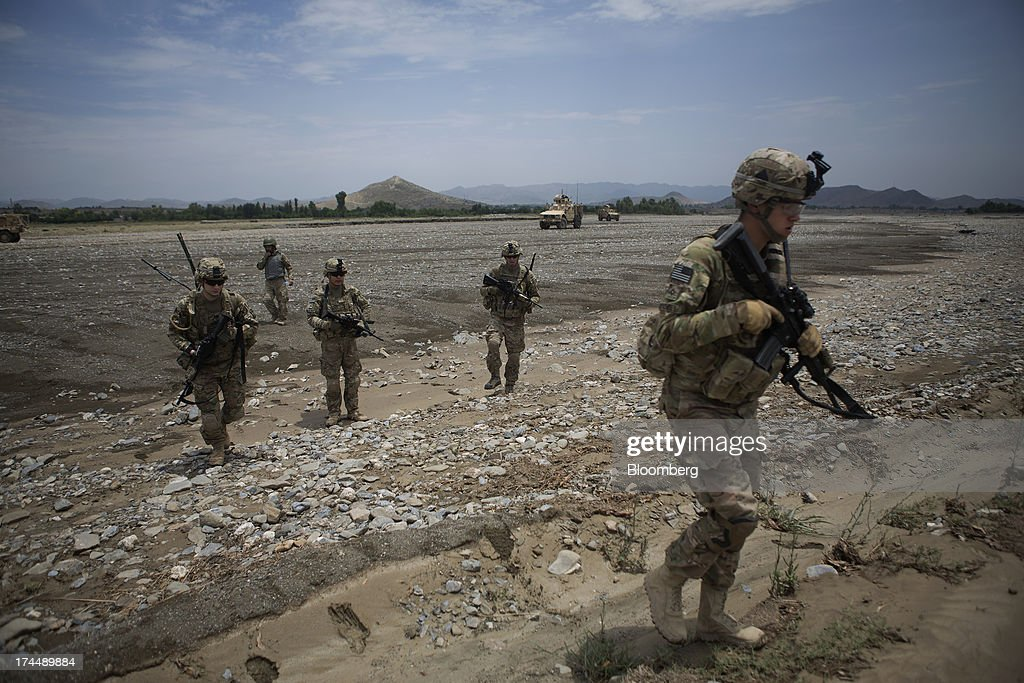 Soldiers from 2nd Platoon Fox Co. of the 2-506th Infantry Battalion of the 4th Brigade of the 101st Airborne Division conduct a counter indirect fire patrol from their base at COP Sabari in the Sabari district of Khost province, Afghanistan, on Sunday, June 30, 2013. U.S. President Barack Obama has maintained his position of ending U.S. combat in Afghanistan by the end of next year, though that plan has included keeping in place several thousand troops for support. Photographer: Victor J. Blue/Bloomberg via Getty Images