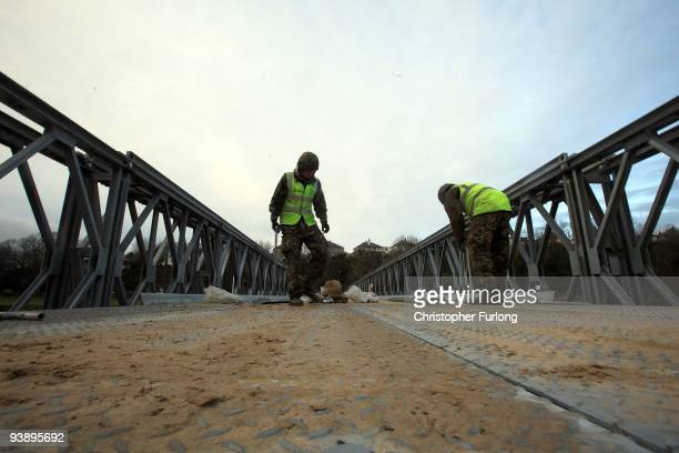 Soldiers from 3 Armoured Engineer Squadron construct a foot bridge across the river Derwent on December 4 2009 in Workington England The bridge will...