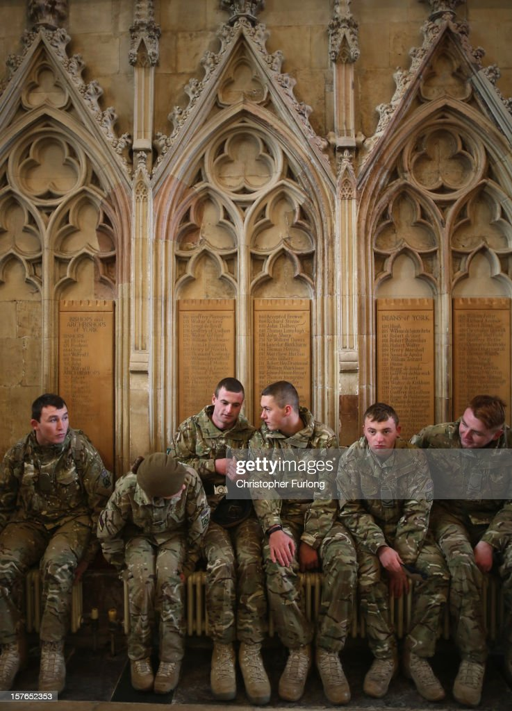 Soldiers from 3rd Battalion Yorkshire Regiment warm themselves on the radiators of York Minster during a homecoming service on December 5, 2012 in York, England. Soldiers from the 3rd Battalion Yorkshire Regiment marched through the City of York before attending a thanksgiving and remembrance service at York Minster. The soldiers have recently completed a six-month tour of duty in Afghanistan where they lost seven comrades including six in one Taliban attack.