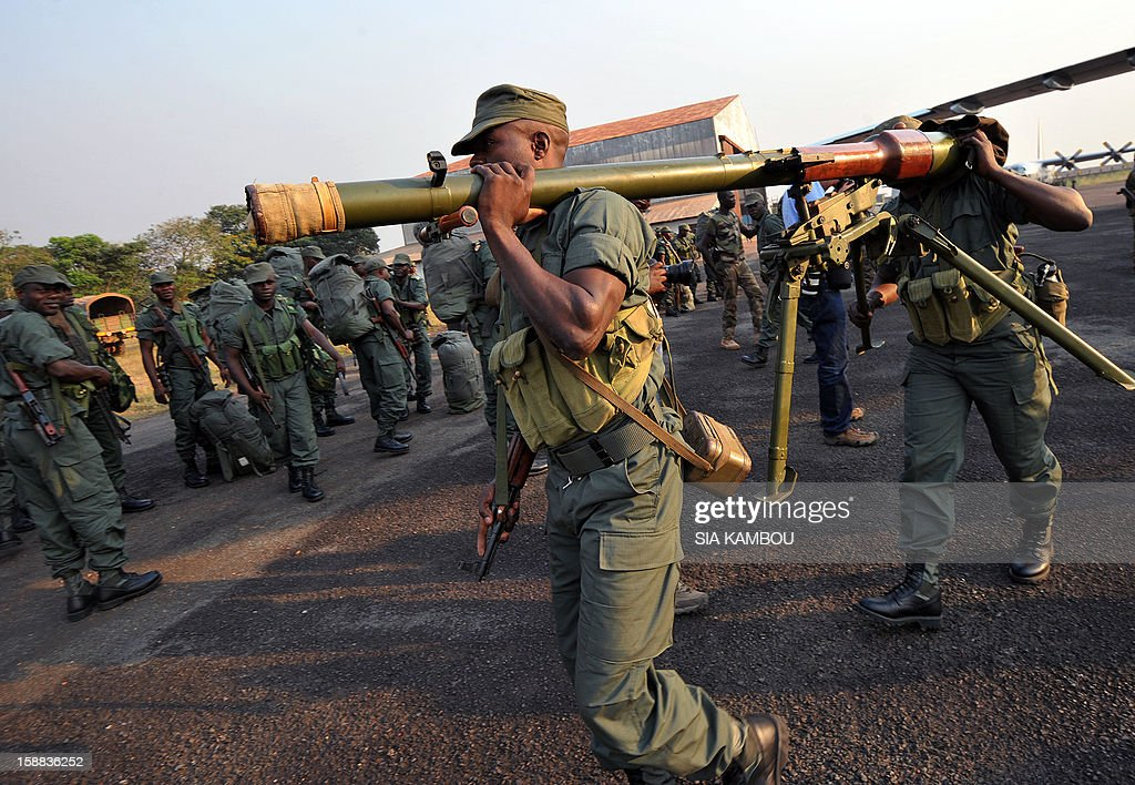Soldiers from Congo Brazzaville, part of the Multinaional Force of the Economic Community of Central African States (FOMAC), unload military equipment as they arrive at the airport in Bangui, on December 31, 2012. Congo announced today the deployment of a battalion of 120 soldiers to the Central African Republic's capital Bangui at the request of the Tchadian President Idriss Deby, who is currently the president of FOMAC. Meanwhile rebels in the Central African Republic vowed to take the last key town before the capital and renewed their call for the president to stand down, voicing scepticism over his pledge to make concessions.