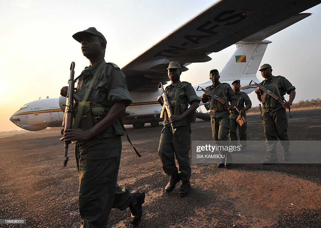 Soldiers from Congo Brazzaville, part of the Multinaional Force of the Economic Community of Central African States (FOMAC), arrive at the airport in Bangui, on December 31, 2012. Congo announced today the deployment of a battalion of 120 soldiers to the Central African Republic's capital Bangui at the request of the Tchadian President Idriss Deby, who is currently the president of FOMAC. Meanwhile rebels in the Central African Republic vowed to take the last key town before the capital and renewed their call for the president to stand down, voicing scepticism over his pledge to make concessions. AFP PHOTO / SIA KAMBOU