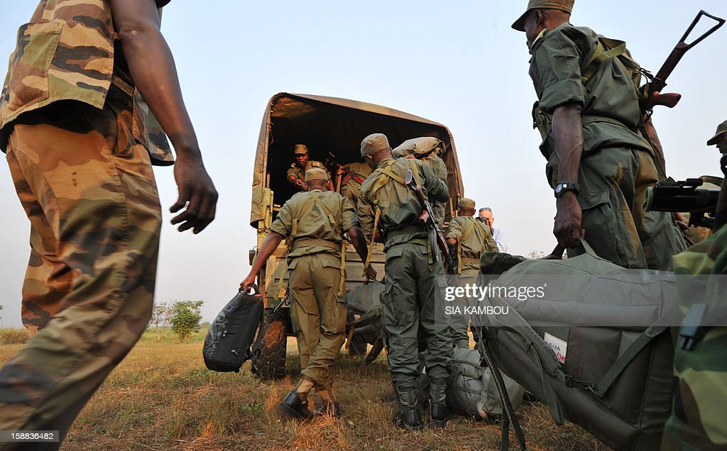 Soldiers from Congo Brazzaville, part of the Multinaional Force of the Economic Community of Central African States (FOMAC), arrive at the airport in Bangui, on December 31, 2012. Congo announced today the deployment of a battalion of 120 soldiers to the Central African Republic's capital Bangui at the request of the Tchadian President Idriss Deby, who is currently the president of FOMAC. Meanwhile rebels in the Central African Republic vowed to take the last key town before the capital and renewed their call for the president to stand down, voicing scepticism over his pledge to make concessions.
