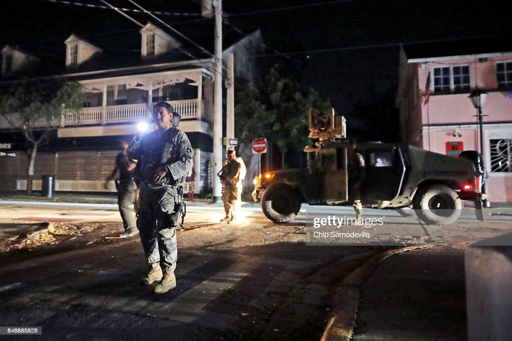 Soldiers from Delta Company, 1st Battallion, 124th Infantry, 53rd Infantry Brigade Combat Team Duval Street for suspected looters during a nighttime patrol four days after Hurricane Irma September 14, 2017 on Key West, Florida. Many places in the Keys still lack water, electricity or mobile phone service and residents are still not permitted to go further south than Islamorada. The Federal Emergency Managment Agency has reported that 25-percent of all homes in the Florida Keys were destroyed and 65-percent sustained major damage when they took a direct hit from Hurricane Irma.