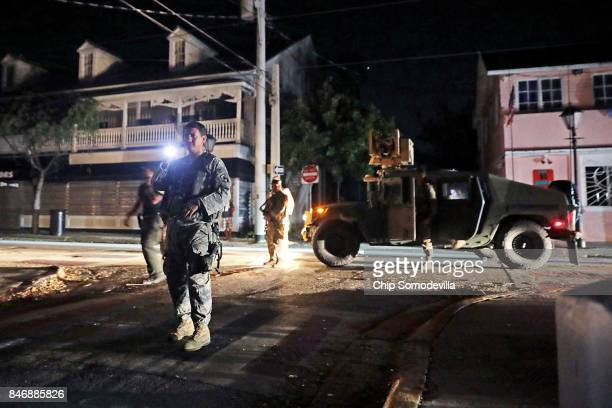 Soldiers from Delta Company 1st Battallion 124th Infantry 53rd Infantry Brigade Combat Team Duval Street for suspected looters during a nighttime...
