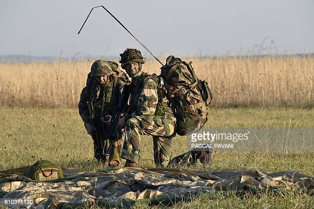 Soldiers from France's 11th Parachute Brigade perform during the 'Colibri' interallied exercise reuniting thousands of French German American Spanish...