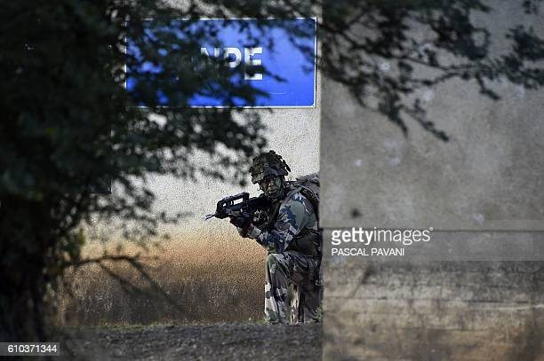 A soldiers from France's 11th Parachute Brigade performs during the 'Colibri' interallied exercise reuniting thousands of French German American...