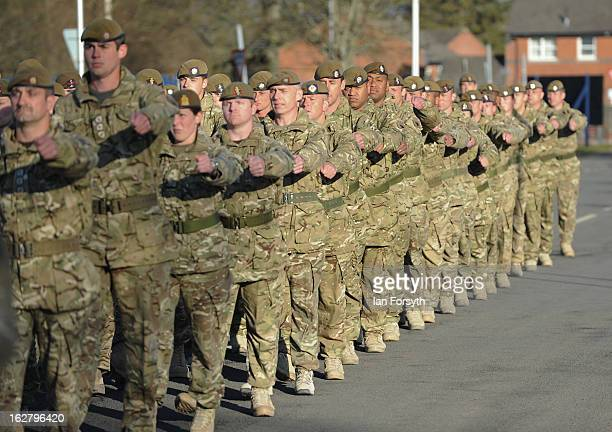 Soldiers from Headquarters Company 1st Battalion The Scots Guards return to their base at Bourlon Barracks and are reunited with their families...