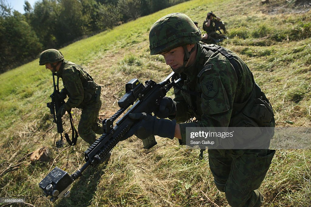 Soldiers from Lithuania counterattack in an ambush by Ukrainan soldiers on the third day of the 'Rapid Trident' bilateral military exercises between...