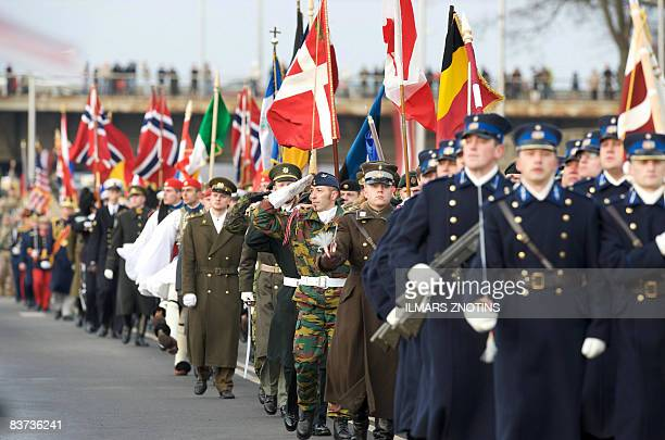 Soldiers from NATO member countries march during a military parade on November 18 2008 to celebrate Latvia's 90th anniversary of independence from...