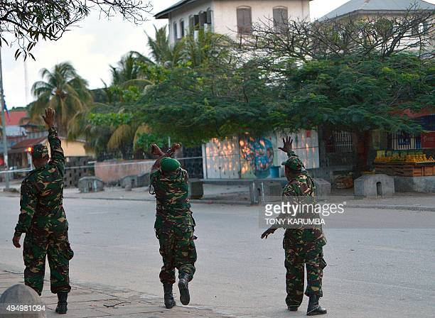Soldiers from Tanzania People's Defence Forces secure the site of a controlled detonation of a suspected improvised explosive device on October 30...