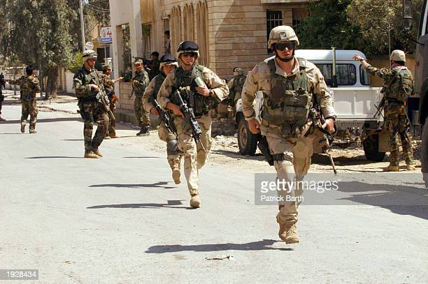 US soldiers from the 10th Mountain Brigade are deployed to secure the AlJumhuri Hospital from attacks April 13 2003 in Mosul Iraq The hospital was...