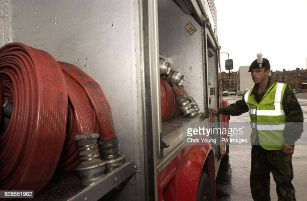 Soldiers from the 1st Battalion of the Royal Welch Fusiliers inspect the Red Goddess fire engine they will man at Chelsea Barracks London Last ditch...