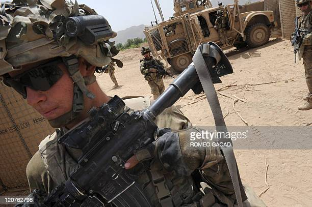 US soldiers from the 1st Platoon Charlie Company 287 Infantry 3rd Brigade Combat Team prepare to pull out from a patrol base on the outskirts of...