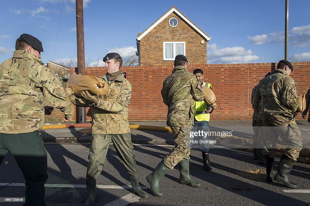 Soldiers from the 1st Regiment Royal Horse Artillery distribute sandbags on February 16 2014 in Staines, England. Housing near the river Thames has suffered a week of flooding after the river burst its banks on February 10, 2014.