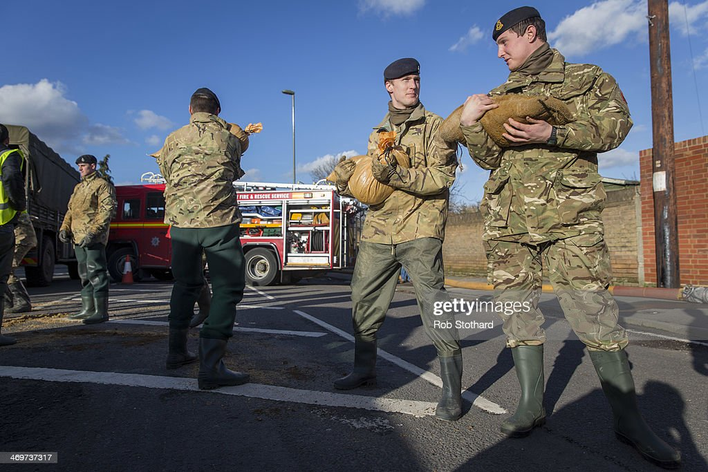Soldiers from the 1st Regiment Royal Horse Artillery distribute sandbags on February 16 2014 in Staines, England. Housing near the river Thames has suffered a week of flooding after the river burst it's banks on February 10, 2014.