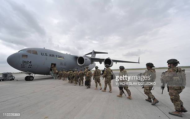 US Soldiers from the 234th Infantry Division Fort Riley Kansas board a plane to Afghanistan from the US transit center Manas 30kms from Bishkek on...