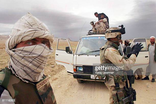 US soldiers from the 287 Infantry stop a vehicle at a check point April 16 2004 near the town of Ghazni Afghanistan US soldiers are trying to create...
