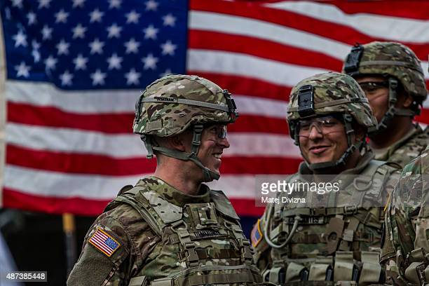S soldiers from the 2nd Cavalry Regiment of the US Army smile before arrival of NATO Secretary General Jens Stoltenberg at the Czech army barracks on...