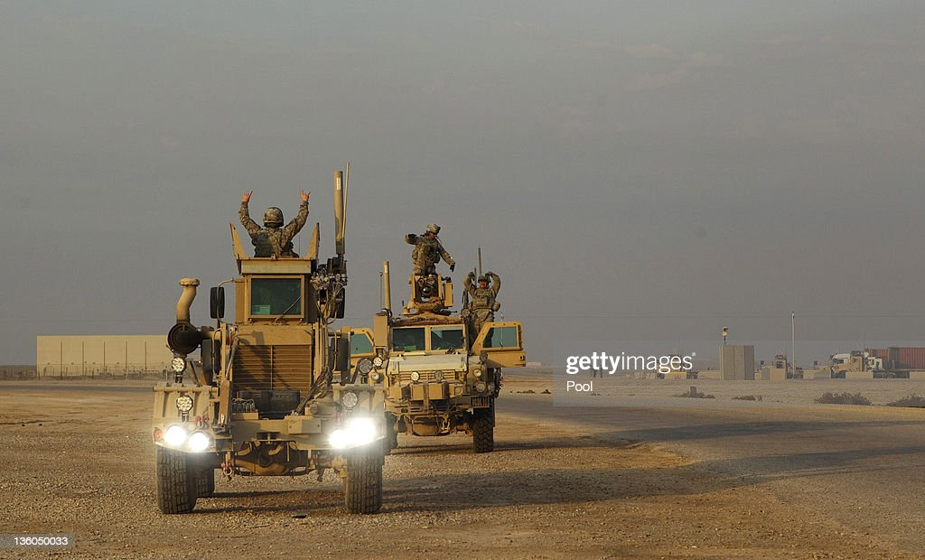 Soldiers from the 3rd Brigade Combat Team, 1st Cavalry Division celebrate through the roof hatches of their Mine Resistant Ambush Protected (MRAP) vehicles as they drive out on the U.S. military's last combat patrol in the country, at Camp Adder on December 16, 2011 near Nasiriyah, Iraq. All U.S. troops were scheduled to have departed Iraq by December 31st, 2011. At least 4,485 U.S. military personnel died in service in Iraq. According to the Iraq Body Count, more than 100,000 Iraqi civilians have died from war-related violence.