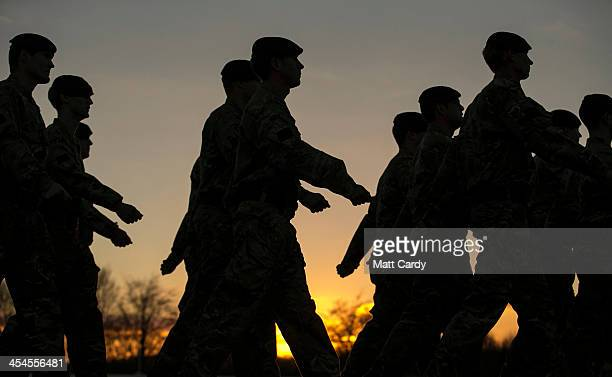 Soldiers from the 4th Battalion The Rifles march from the parade ground after they received medals to mark their return from Afghanistan at their...