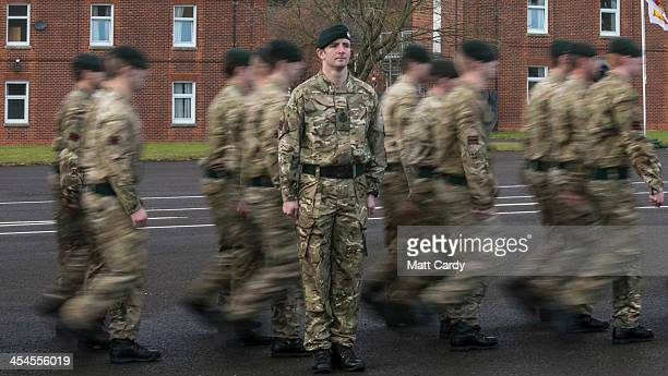 Soldiers from the 4th Battalion The Rifles march onto the parade ground to receive medals to mark their return from Afghanistan at their barracks in...