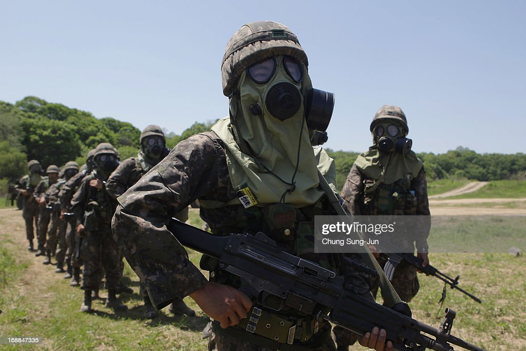 US soldiers from the 4th Chemical Company 23rd Chemical Battalion 1st Armored Brigade Combat Team of 2nd Infantry Division participate in...