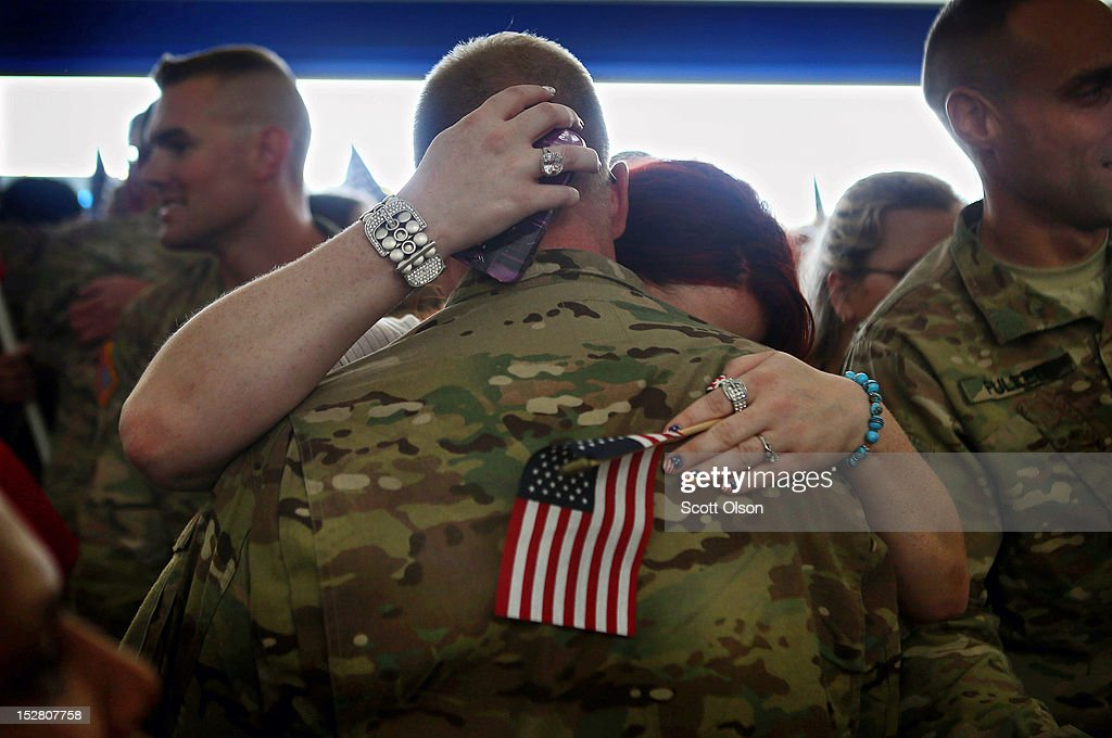 Soldiers from the 713th Engineer Company of the Indiana Army National Guard are greeted by family and friends at a homecoming ceremony at the Army Aviation Support Facility on September 26, 2012 in Gary, Indiana. The 713th Engineers were returning from a deployment in Kandahar Province, Afghanistan. Six soldiers from the unit were killed during the deployment.