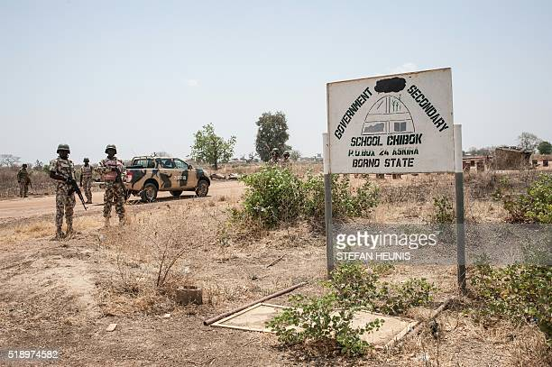 Soldiers from the 7th Division of the Nigerian Army stand outside the Government Girls Secondary School Chibok in Borno State northeastern Nigeria on...