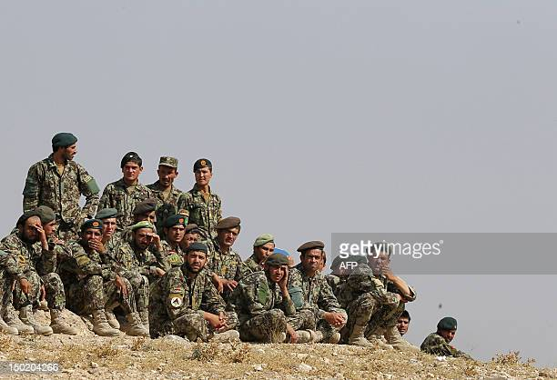 Soldiers from the Afghan National Army observe training exercises and manoeuvres operated by French Army's mentors members of the 'Epidote' unit at...