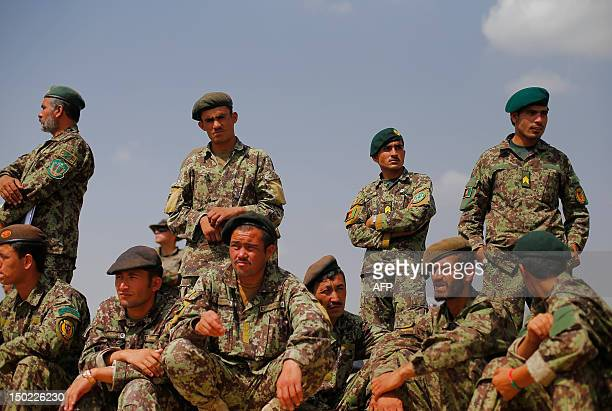 Soldiers from the Afghan National Army watch Camp PoleCharki training exercises and maneuvers operated by French Army's mentors members of the...