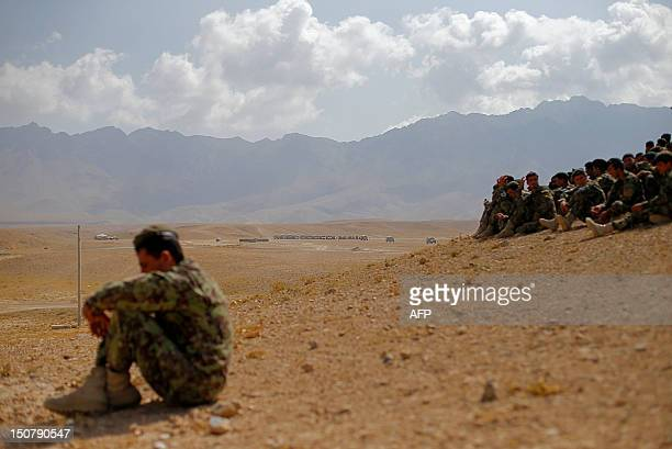 Soldiers from the Afghan National Army watch training exercises and tactical manoeuvres operated by French Army's mentors members of the 'Epidote'...