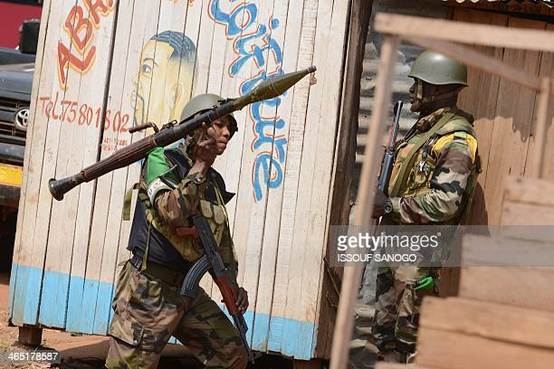 Soldiers from the Africanled International Support Mission to the Central African Republic patrol in the Miskine neighborhood of Bangui on January 26...