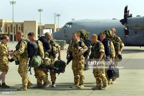 Soldiers from the Black Watch walk along the airport runway to board a Hercules C130 at Basra International Airport The Black Watch battle group with...