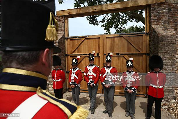 Soldiers from the Coldstream Guards dressed in period costume take part in the ceremonial closing of the North Gate of Hougoumont Farm originally...