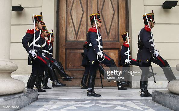 Soldiers from the elite Grenadier Regiment march toward the Casa Rosada presidential palace following a changing of the guard ceremony on November 21...